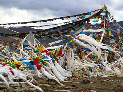 Prayer flags on a mountain pass - Tibet Photo Journal - Steven Andrew Martin