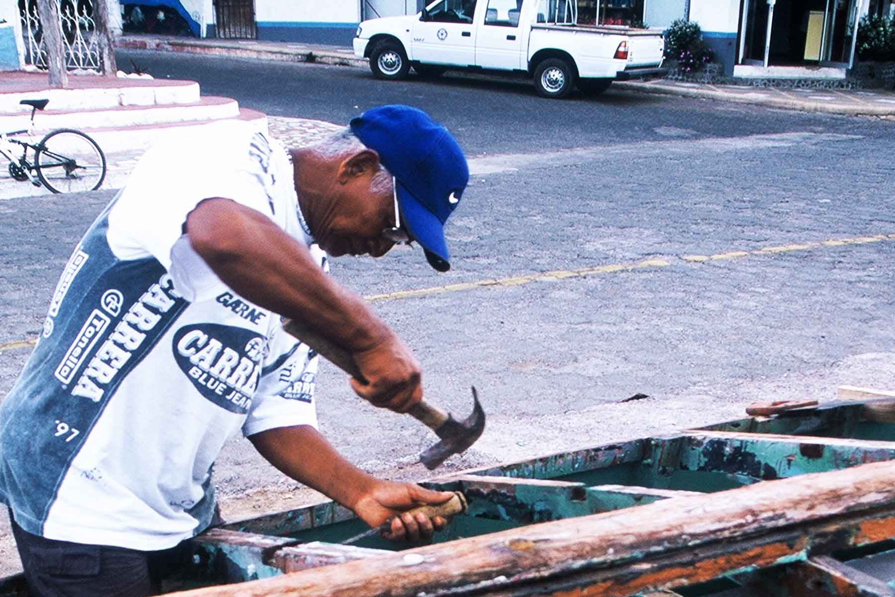 Fisher working on his boat | Dr. Steven A. Martin | Galapagos Photo Journal | Environmental Studies