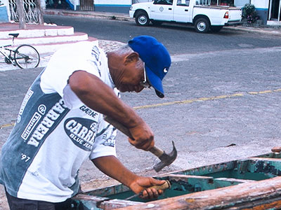 fisher working on his boat - Steven Andrew Martin - Galapagos Photo Journal