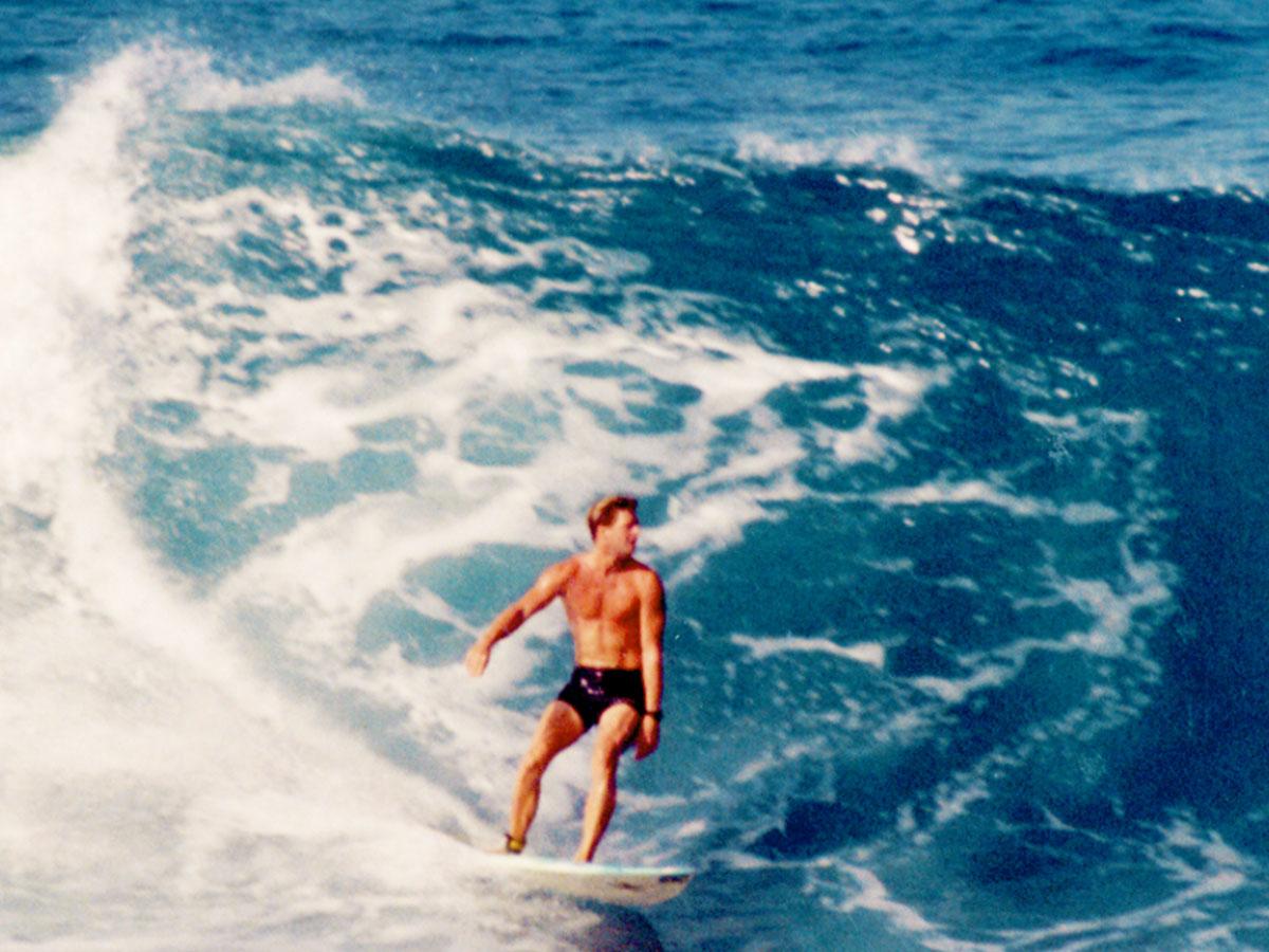 Surfing Magic Sands Point, Kona, Hawaii, in 1990, Steven A Martin